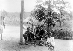 Men and a child with a newly shot leopard in Banten, West Java, circa 1915–1926.